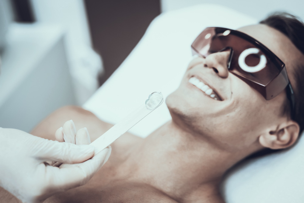 man getting laser hair removal treatment